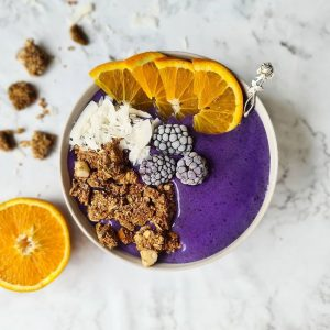 Purple smoothie bowl with toppings
